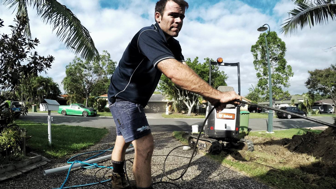 Eastern Suburbs plumber clearing a blocked drain
